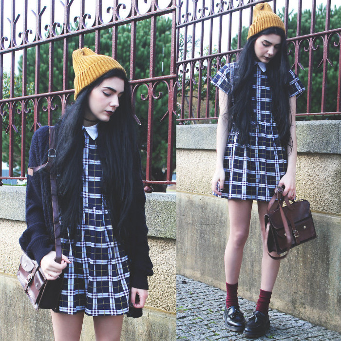 beanie hat in yellow, worn by black-haired young woman, in a plaid mini dress, with peter pan collar, 90s clothes womens, leather satchel bag