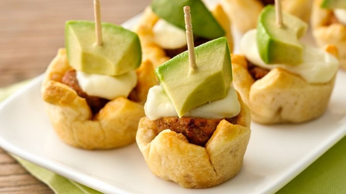 edible tiny baskets, filled with meatballs, and topped with a white sauce, and avocado pieces, hors d oeuvres recipes, for parties or dinners