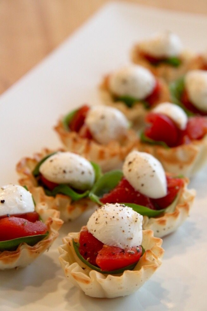 tartlets stuffed with chopped tomato, fresh basil leaves, and mozzarella sprinkled with pepper, horderves ideas, for special occasions