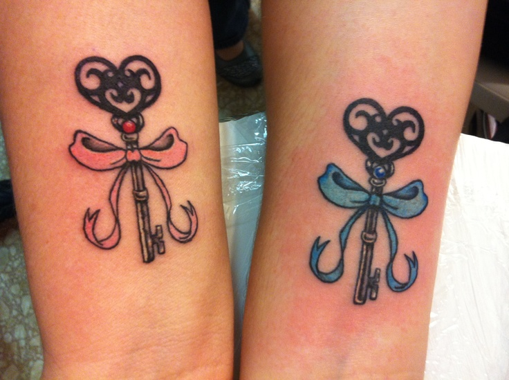 baby pink and baby blue bows, tied around vintage, heart-shaped ornate keys, matching sister tattoos, on two wrists
