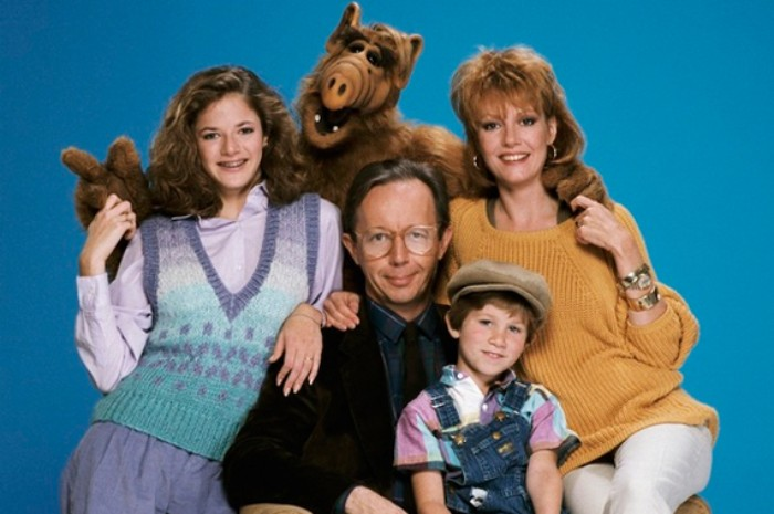 alf actors posing together, dressed in vinatge clothes, 80s fashion trends, knitted sweater and vest, smart suit and dungerees