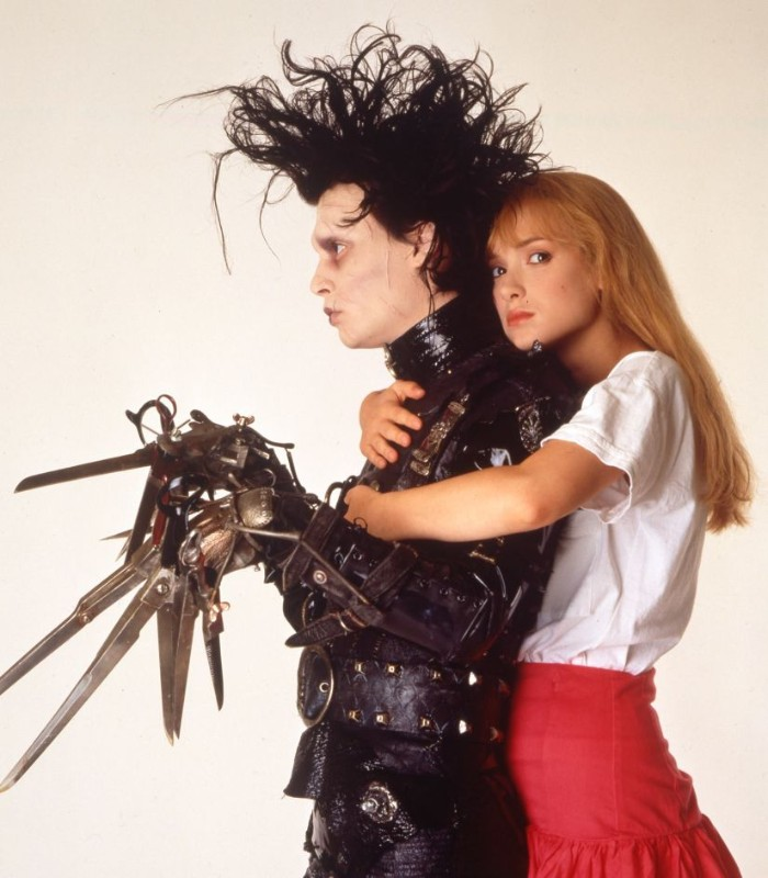 80s costumes men, johnny depp in the film edward scissorhands, black leather costume, with metal elements, and messy black wig, winnona ryder with long ginger hair
