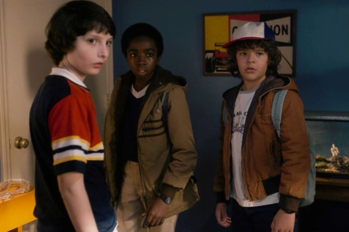 caleb mclaughlin and gaten matarazzo and finn wolfhard, dressed in retro clothes, for the series stranger things, 80s costumes men and kids