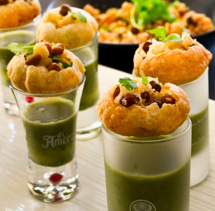 hor d oeuvres ideas, fish cakes with red beans and parsley, topping shot glasses, filled with green dip