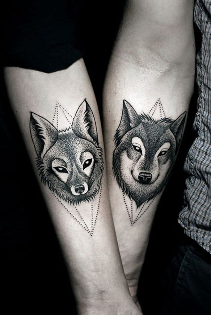 fox and wolf, done with black ink, in a pointilist style, husband and wife tattoos, bellow the elbow crooks of two liked hands