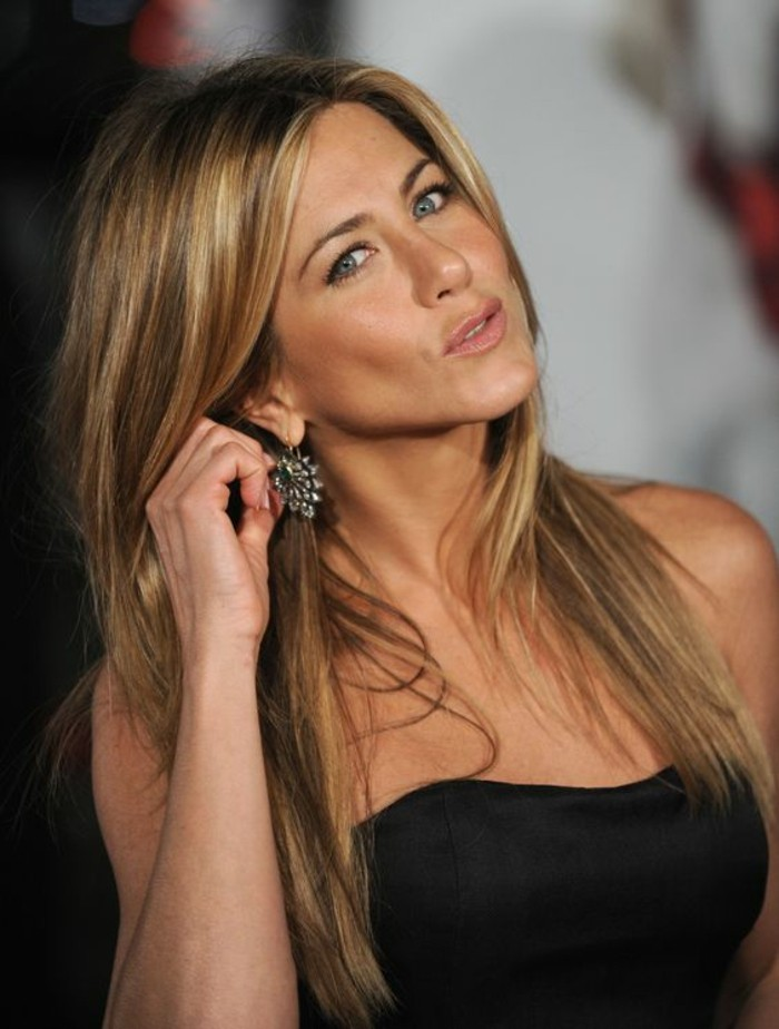 straw blonde bayalage, on jennifer aniston's brunete hair, black strapless dress, and large earrings