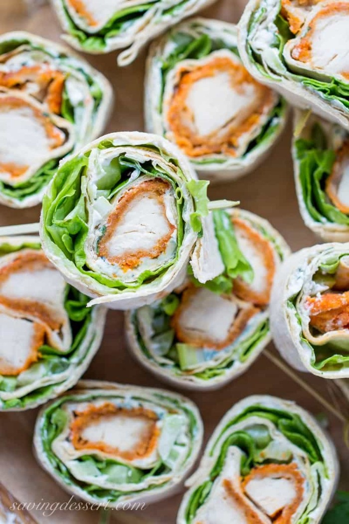 wraps filled with breaded chicken fillets, lettice and white sauce, cut into small, bite-sized pieces