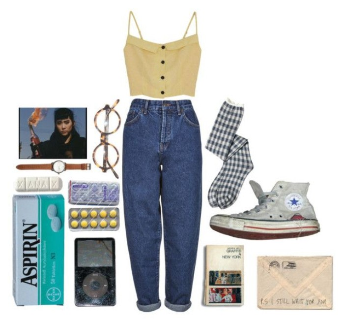 baggy high waisted mom jeans, and a pale yellow crop top, with button details, surrounded by various vintage accessories, worn converse sneakers, checkered socks and glasses, ipod and pills