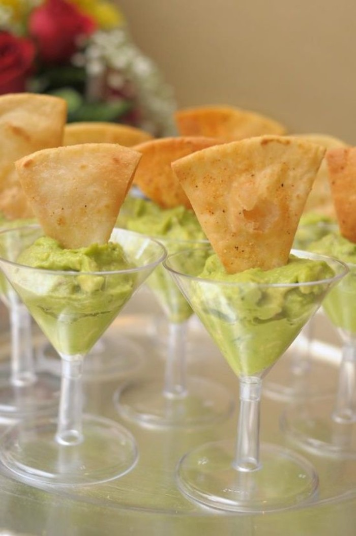 riangular slices of toasted pitta bread, dipped in plastic cocktail glasses, filled with guacamole, hor dorves