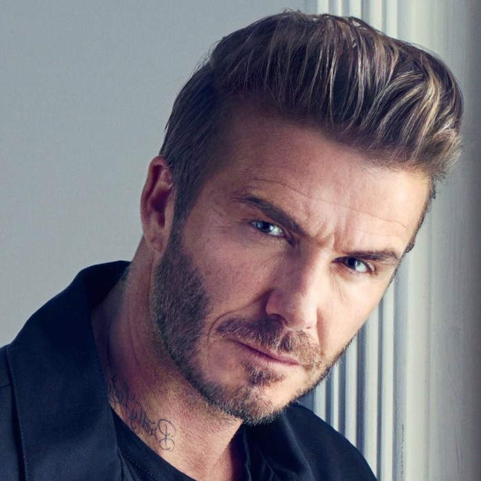 older david beckham, wearing a slicked back quiff, short guy haircuts, with an undercut, a short beard, and a mustache