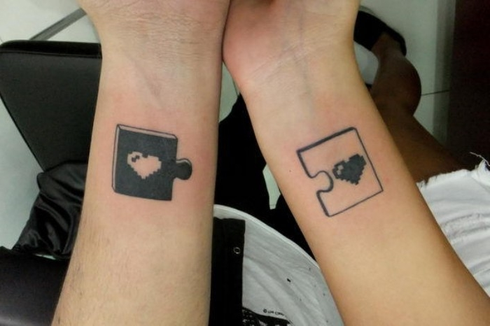 pixelated hearts in black and white, depicted on matching puzzle pieces, in contrasting colors, matching tattoos for couples