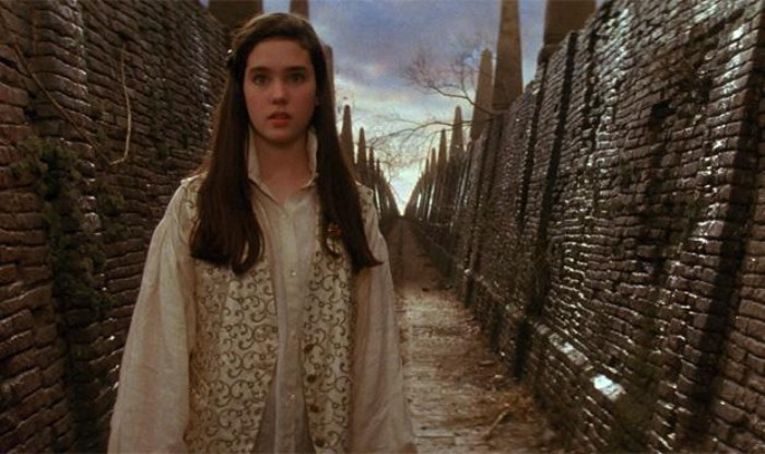 80s fashion trends, young jenniffer connelly, in the film labyrinth, dressed with an oversized shirt, and a patterned vest