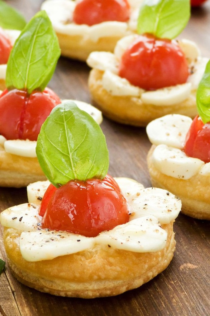 pastries topped with baked cherry tomatoes, mozzarella and fresh basil leaves, appetizers for a crowd, easy and delicious