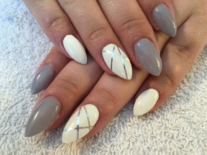 creamy grey and white nail polish, on short stiletto nails, decorated with metallic silver stripes