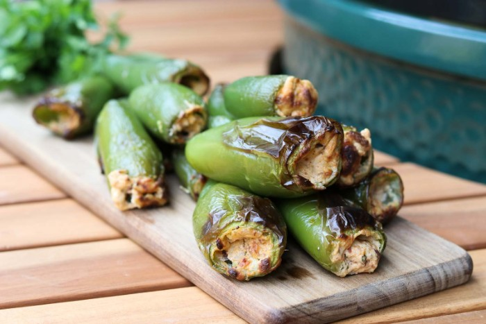 stuffed jalapeno peppers, filled with cheese, and baked in the oven, hor d oeuvres ideas, placed on a wooden board