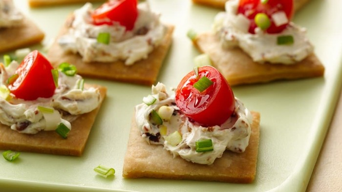 creamy spread with spring onions, on top of several square crackers, with cherry tomatos, hors d oeuvres recipes