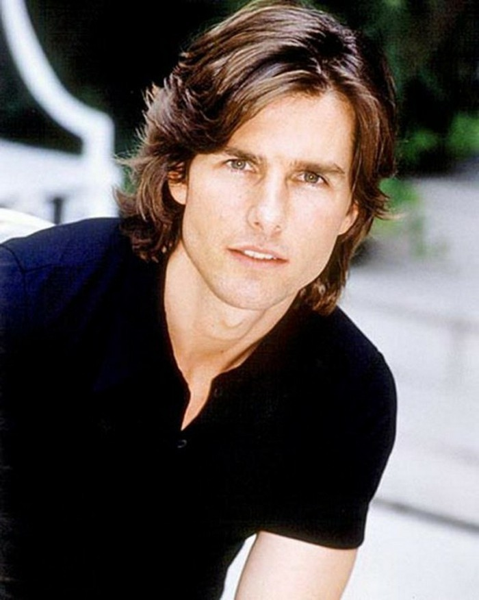 mid length wavy, shiny brunette hair, with a middle part, worn by young tom cruise, in a black top