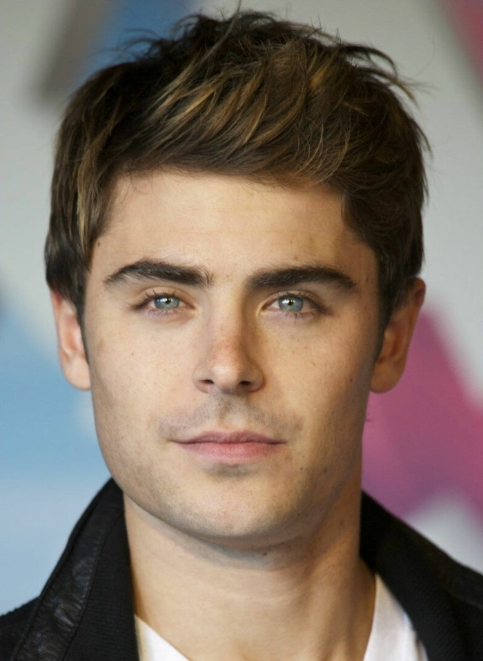side swept quiff, on brunette hair, with subtle highlights, worn by zac efron, in a black leather jacket
