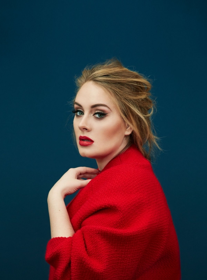cardigan in red, worn by the singer adele, messy dark blonde hair, with light blonde highlights, black eyeliner and red lipstick