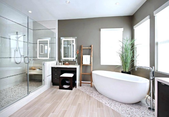 best bathroom paint colors, medium grey and white walls, in a bright room, with three windows, an oval tub, and a large glass shower cabin