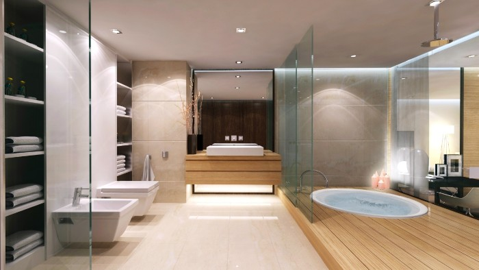 large room with pale cream floor, and wooden details, containing an inbuilt tub, a toilet seat and a bidet, bathroom remodel pictures, glass walls and a large mirror