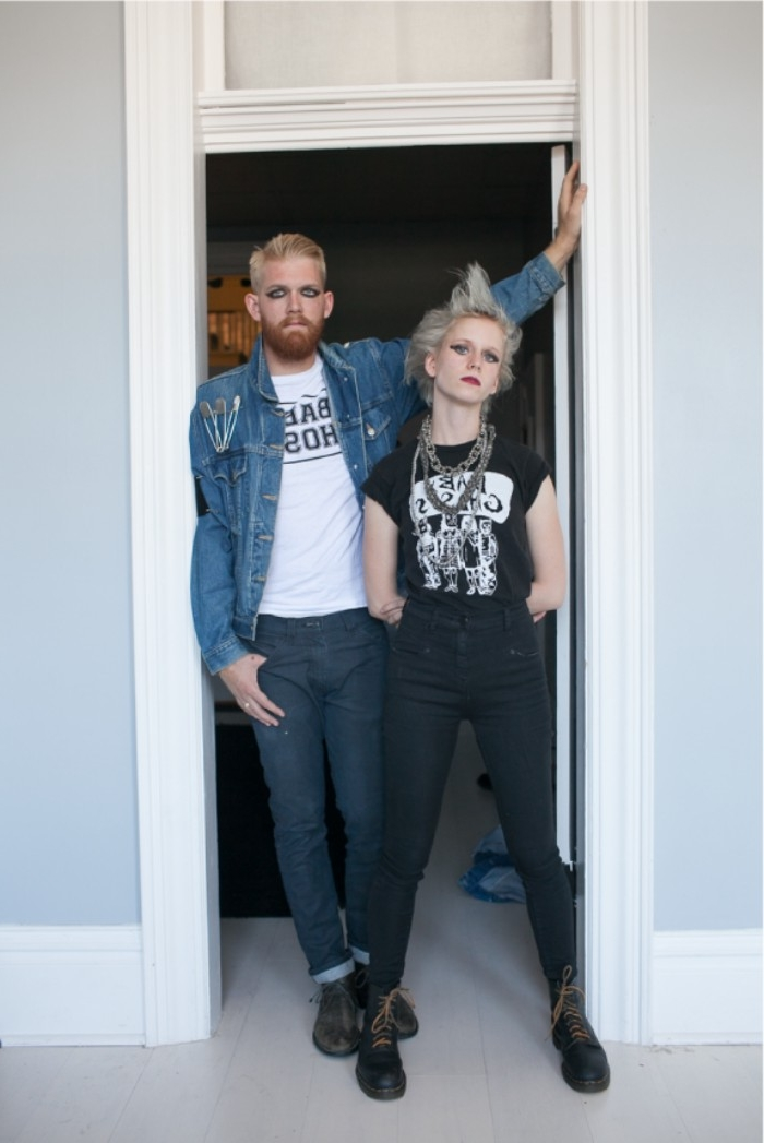 punk rocker couples halloween costume ideas, pale blonde woman, with spiky platinum blonde hair, dressed in black, near a man with dark eye makeup, dressed in denim
