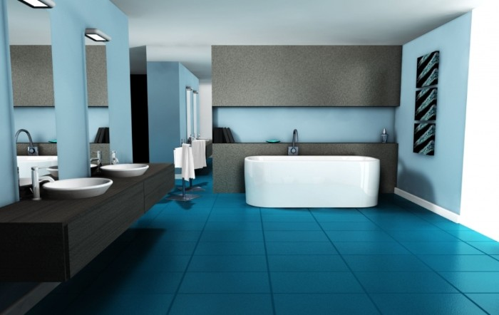 spacious bathroom with blue tiled floor, pale blue walls with grey details, a white bathtub, two tall mirrors, and two white sinks, on a black counter