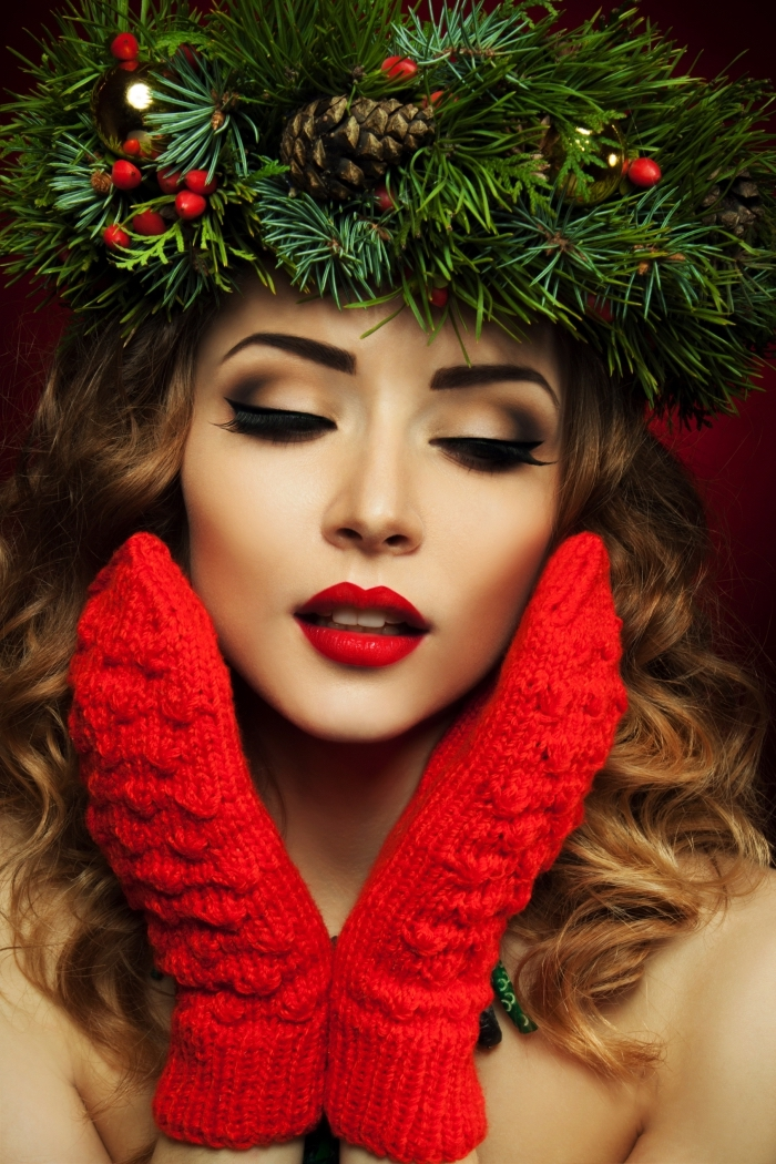 mittens in red, worn by a pale brunette woman, with curled hair, christmas makeup looks, red lipstick and smokey eye makeup, christmas werath on her head