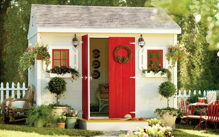 red and white shed, inside a garden, with potted plants and shrubs, shed ideas, tiled roof in light grey