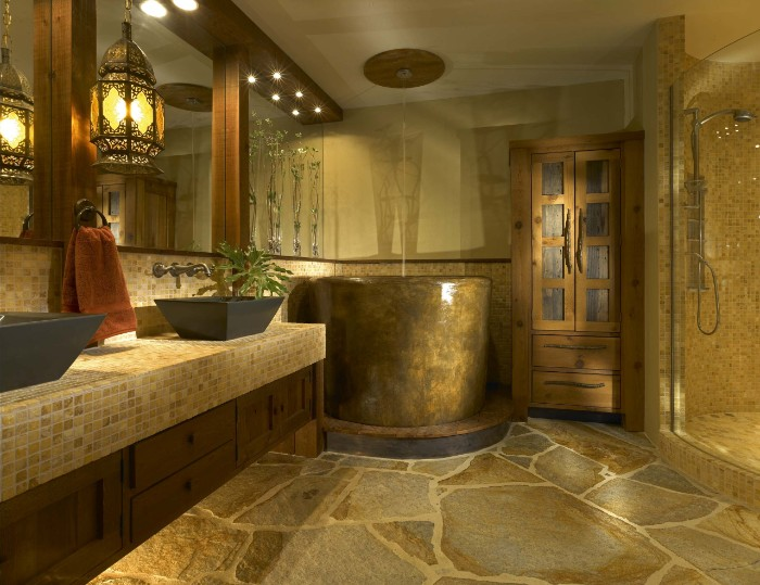 master bathroom remodel, stone covered floor, in brown and grey, inside a room with a tall, round brown bath tub, asian decorative motifs