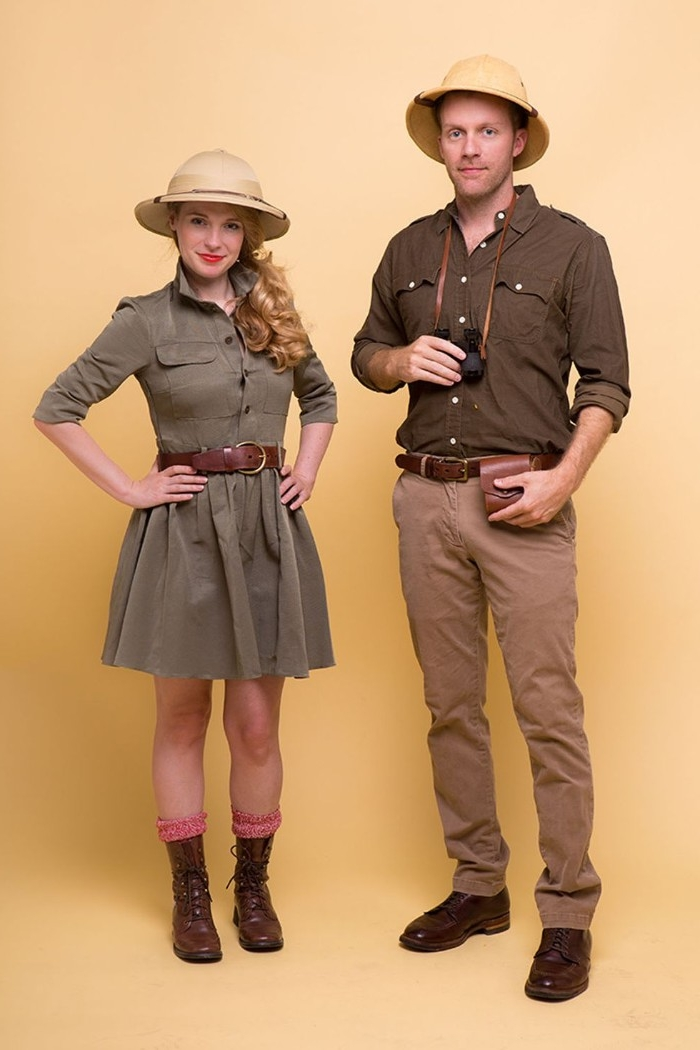 female and male exlorer outfits, worn by a smiling blonde woman, and a tall man, duo halloween costumes, indiana jones or safari