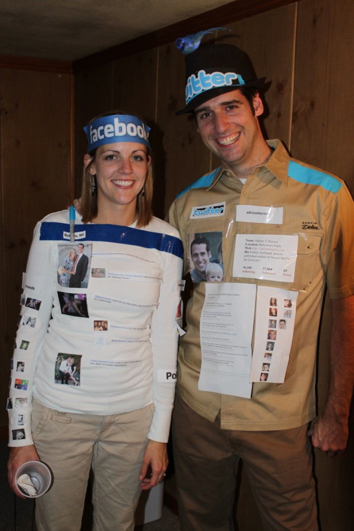 twitter and facebook costumes, made from paper print outs, stuck to the clothes of a smiling man and woman, quick halloween costumes