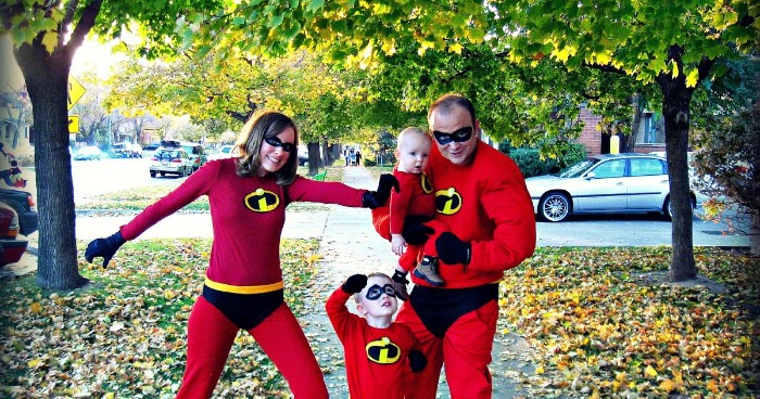mother and father, and two small children, dressed like the superheroes, from disney pixar's the incredibles, family halloween costumes