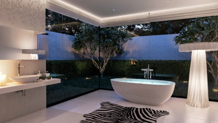 faux zebra skin carpet, on a white tiled floor, inside a modern bathroom, with a white bathtub, and large windows overlooking a garden