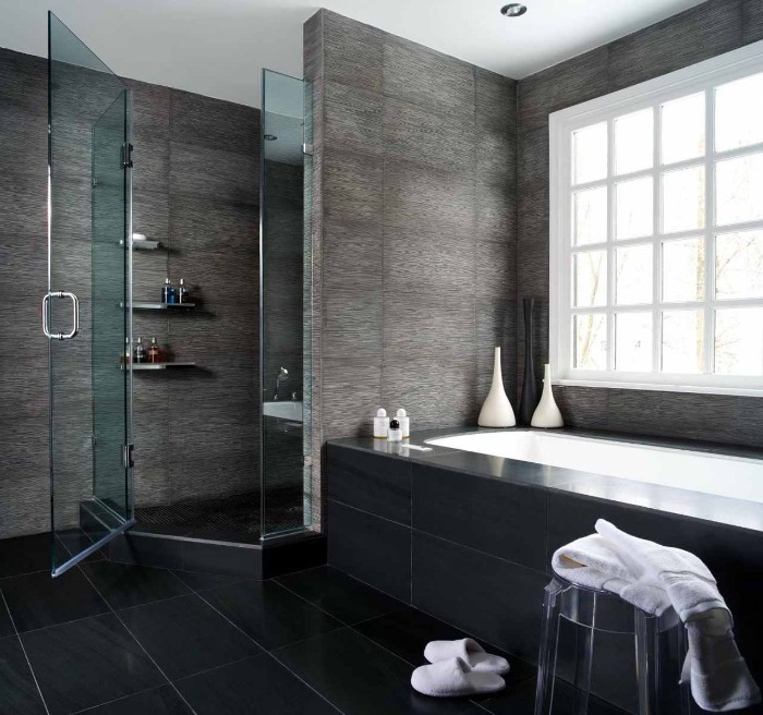pewter grey tiles, on the walls of a room, featuring a bathtub, and a shower cabin, bathroom picture ideas, black tiled floor, clear plastic chair