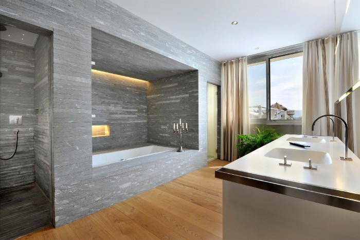 bath remodel ideas, large and bright room, with wooden floor, and a shower cabin and bathtub area, decorated with grey tiles