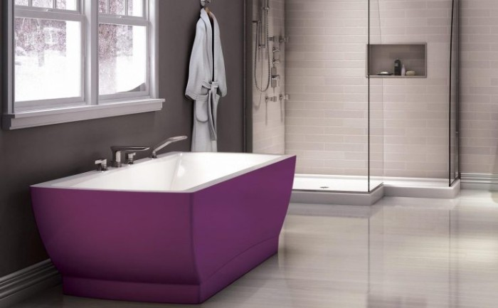 contrasting purple bathtub, in a bathroom with medium grey walls, light grey floor, and a shower cabin, with white subway tiles