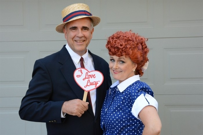 elderly couple dressed like lucy and ricky ricardo, from the tv series i love lucy, couple costume ideas, costume and a straw hat, blue dress with white polka dots, and a red curly wig