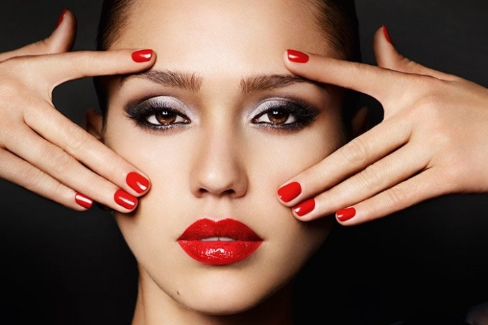 smokey eye make up, with silver and dark grey eye shadow, christmas eye makeup, on jessica alba, wearing red lipstick, and matching red nail polish