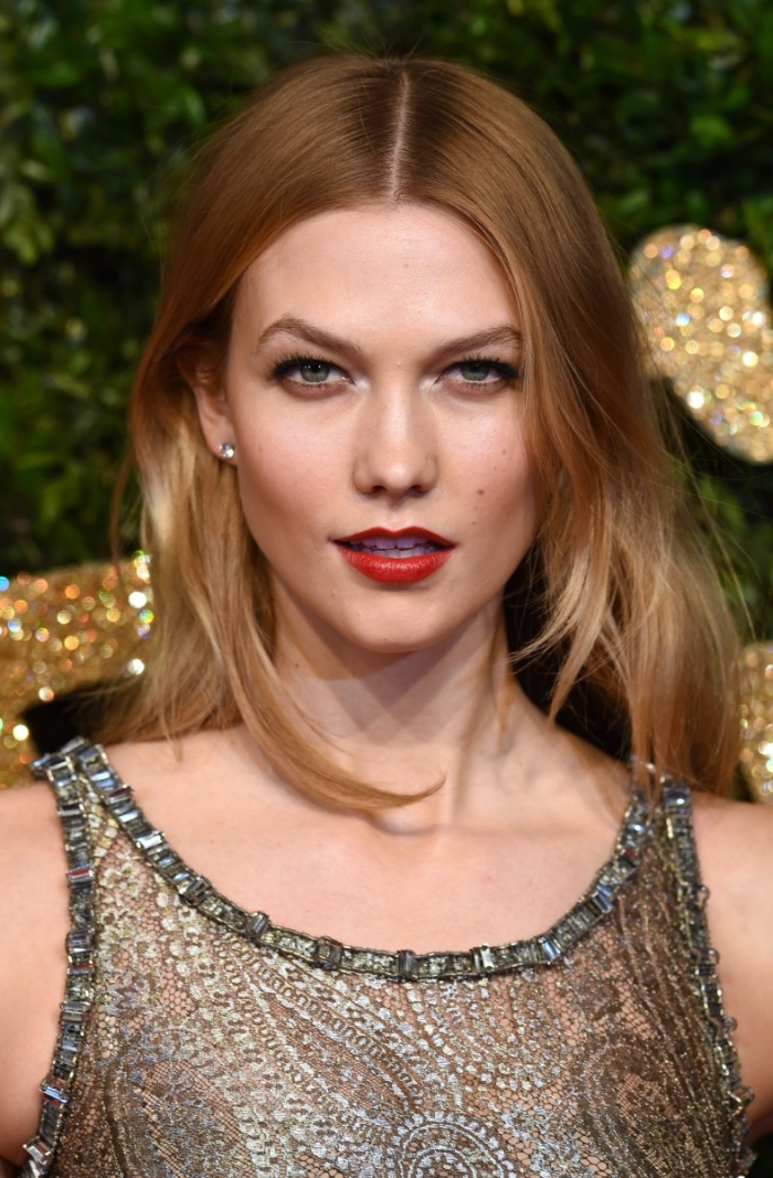 embroidered dress in silver, worn by karlie kloss, with red lipstick, black mascara and ombre hair