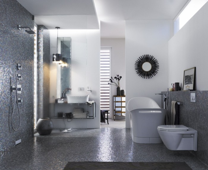 spa like bathrooms, grey mosaic tiles, covering the floor, and part of the walls, open-space shower area, a white tub, and a toilet seat