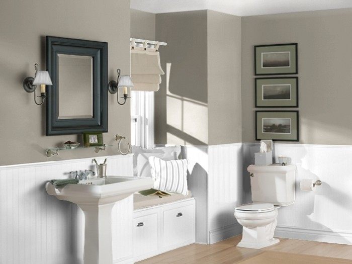 creamy grey walls, with white wooden panels, in a room with a laminate floor, bathroom color schemes, off-white sink and toilet