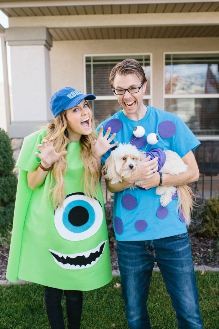 sully and mike from monster's ink, cute couple halloween costumes, worn by a young blonde girl, and a man with glasses, holding a dog in costume