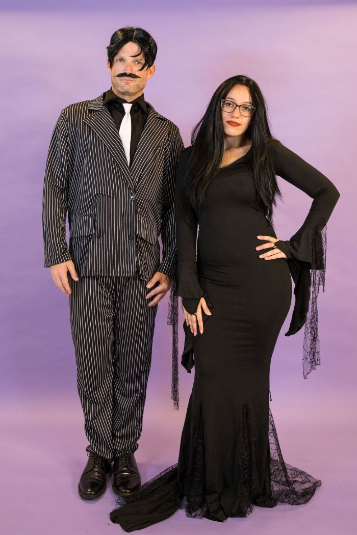 addams family-inspired outfits, woman in a black wig, dressed in a black maxi dress, and man with a faux mustache, in a striped suit, duo halloween costumes, duo halloween costumes, gomez and morticia