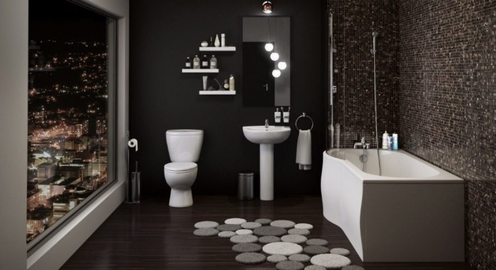 black walls and dark brown floor, inside a bathroom, with a large window, overlooking a city at night, asymmetrical bathtub, toilet and sink