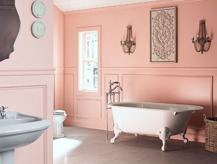 baby pink walls, inside a spacious bathroom, with a vintage style, white clawfoot bath, bathroom color schemes