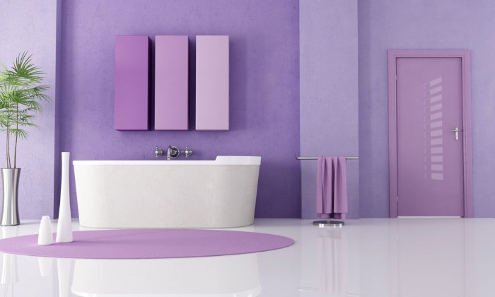 lavender colored room, with glossy smooth white floor, best paint for bathrooms, featuring a white tub, and a round purple rug