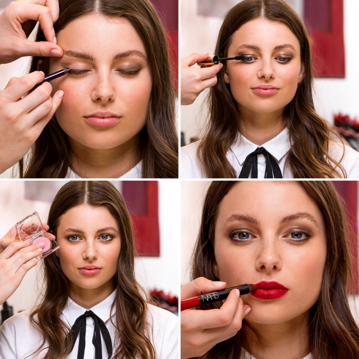 applying eye shadow and mascara, lip gloss, and red lipstick, christmas makeup, on the face of a young brunette woman
