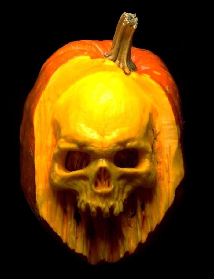 realistic human skull, with lots of detail, carved from an orange pumpkin, skeleton pumpkin, lit from above, on a black background