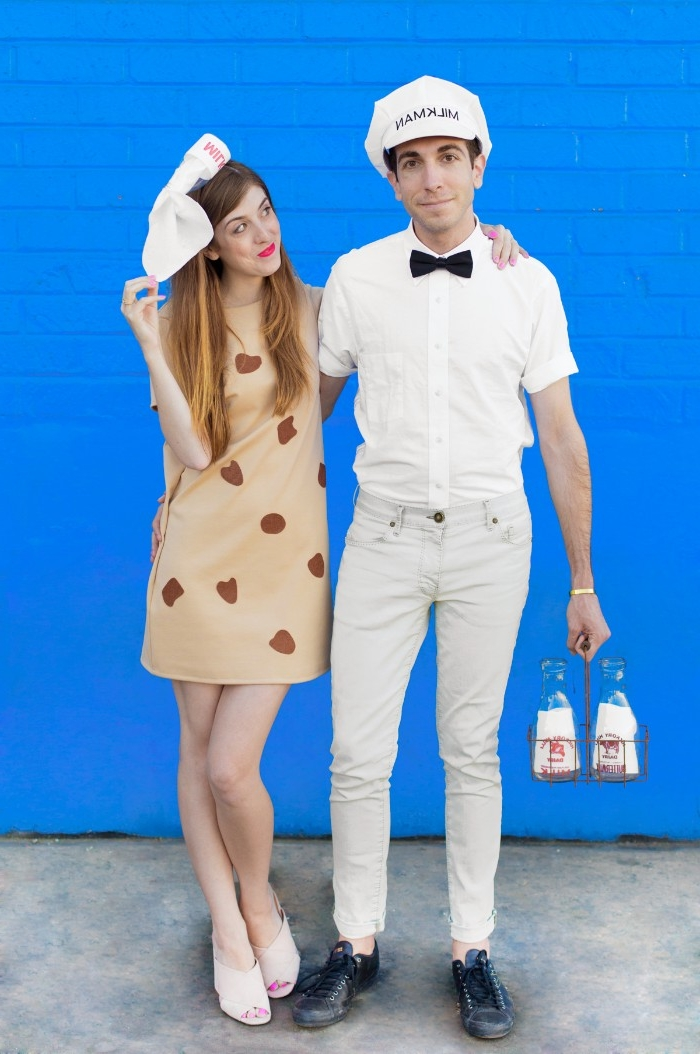 off-white trousers, and a white shirt with black bowtie, worn by a slim man, with a milkman's hat, holding some milk bottles, couple costume ideas,smiling woman,dressed as a cookie